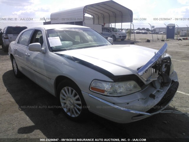 Salvage Car Lincoln Town Car 2004 White For Sale In Clayton Nc