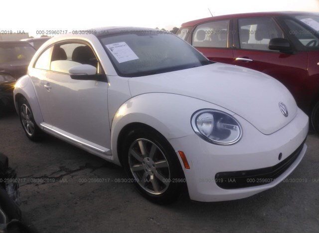Salvage Car Volkswagen Beetle 2012 White for sale in Houston