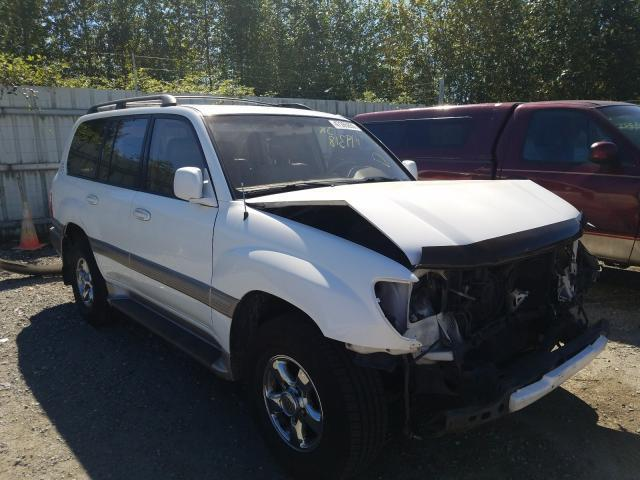 salvage car toyota land cruiser 2000 white for sale in arlington wa online auction jt3ht05j1y0099536 ridesafely
