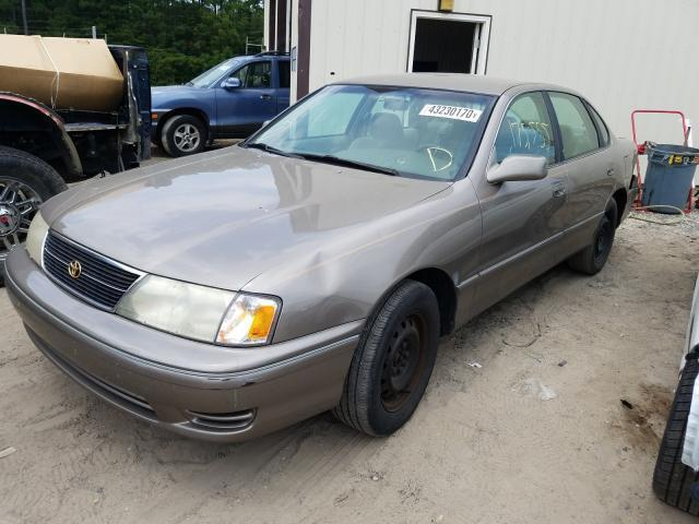 salvage car toyota avalon 1999 beige for sale in seaford de online auction 4t1bf18b1xu334796 ridesafely